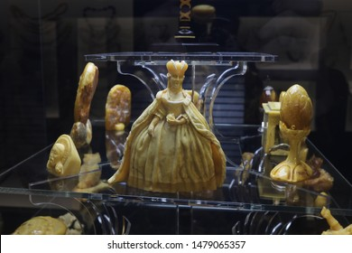 Figures from amber standing on the shelf