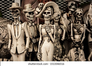 Figures of catrina and catrin or Calavera Garbancera, with Mexican costumes, is a representation of the death and icon of Mexican culture, during the festivities of the day of the dead