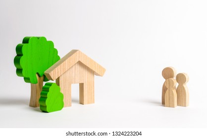 Figures of the family and house on a white background. real estate, your own home. Affordable housing on credit or mortgage. Renovation and construction. Subsidies, citizenship. Buying or selling.