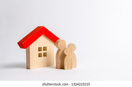 Figures of the family and house on a white background. real estate, your own home. Buying or selling. Affordable housing on credit or mortgage. Renovation and construction. Subsidies, citizenship.