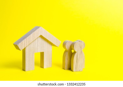 Figures of the family and house on a yellow background. real estate, your own home. Buying or selling. Affordable housing on credit or mortgage. Renovation and construction. Subsidies, citizenship.