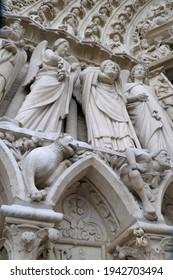 Figures and gargoyles, Notre Dame Cathedral, Paris, Île-de-France, France - Shutterstock ID 1942703494