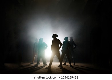 figures of group of dancers looking at one side with soloist,band of dancers.street dancers.synchronous motion