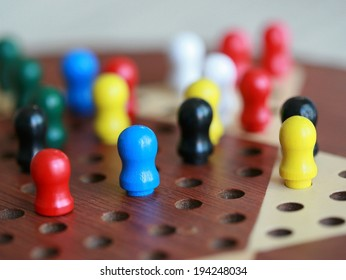 Figures on a Chinese checkers board. Selective focus.