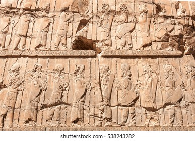 Figures of Persian soldier - people ,Old bas relief sculpture carving on the wall,Persepolis Shiraz,Iran