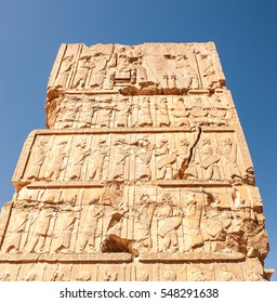 Figures of Persian soldier - people ,Old bas relief sculpture carving,Persepolis,Shiraz,Iran.