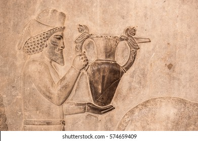 Figures of Persian soldier - people ,Old bas relief sculpture carving on the wall.