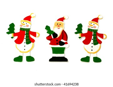 figures Santa Claus and two snowman from wood on white