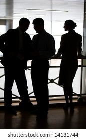 Figures of three business partners standing on balcony and interacting with each other