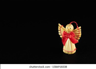 figures of woodden angel isolated on black background - Shutterstock ID 1586918338