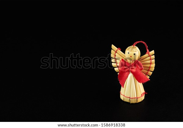 figures of woodden angel isolated on black background