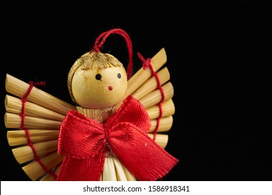 figures of wooden angel isolated on black background - Shutterstock ID 1586918341