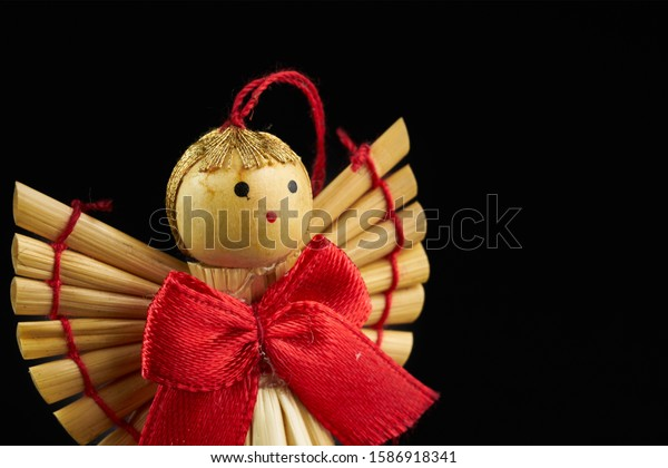 figures of wooden angel isolated on black background