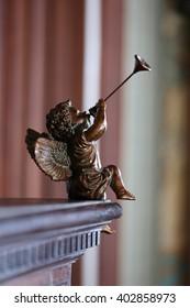 Figurine angel playing trumpet