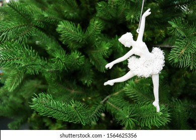 figurine of a ballerina girl on a Christmas tree. greeting card for ballerina