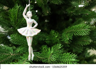 figurine of a ballerina girl on a Christmas tree. greeting card for ballerina