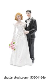 figurine the bride and groom isolated on white