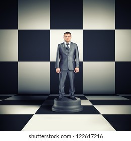 Figurine of businessman in chess room