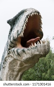 Figurine dinosaur carnivorous allosaurus with detail on head.