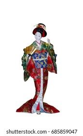 A figurine in the form of a Japanese geisha woman in a kimono. She holds a fan in her hand.
