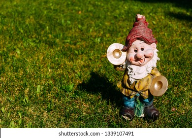 figurine of funny dwarf on the grass
