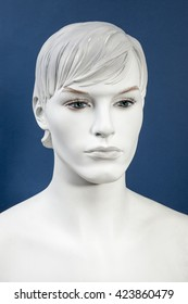 Figurine Head, monochrome on the blue background