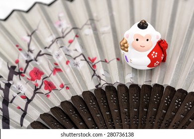 Figurine of Monkey, and a Japanese folding fan. (Japanese New Year customs)