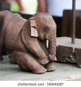 Figurine of a sitting elephant cut from stone