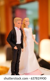figurines of the bride and groom on a wedding box