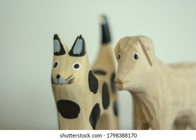 figurines of a cat and a sheep standing on the table