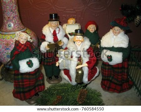 figurines of christmas carolers featured in a victorian christmas at smith mcdowell house asheville