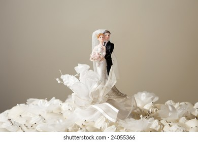 Figurines on top of wedding cake. Copy space