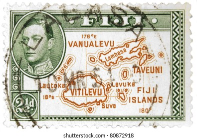 FIJI - CIRCA 1950: A vintage Fijian postage stamp image of a map of the islands with inset of King George and a face value of 2 1/2 pence, series circa 1940