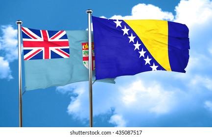 Fiji flag with Bosnia and Herzegovina flag, 3D rendering