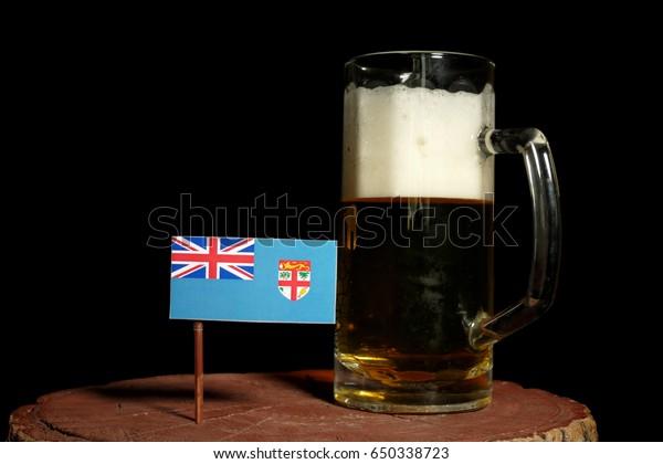 Fijian flag with beer mug isolated on black background