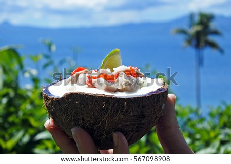 Fijian Food, Kokoda (Raw Fish Salad) against Tropical Island landscape. Kokoda is Fiji's version of ceviche, enriched with coconut milk to balance out all the acid.