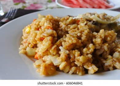 Fijian rice and dal dish served on plate. Food background