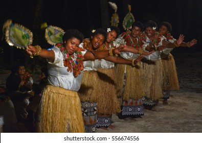Fijian women dancing a traditional female dance Meke the fan dance. Real people copy space