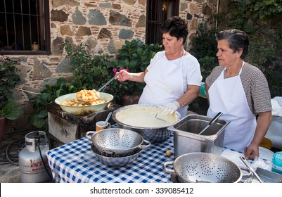 FIKARDOU, CYPRUS - OCTOBER 11: Women preparing and cooking homemade traditional delicious greek loukoumades honey pastry on October 11, 2015 at Fikardou village in Cyprus.
