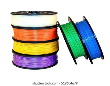 Filament for 3d printing: six coils. The bright blue, green, white, orange, yellow and lilac colors. Isolated on white background. Material is Acrylonitrile butadiene styrene (ABS) polymer.
