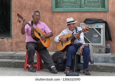 Filandia, Colombia- September 9, 2018: men playing the guitar on the street of the popular tourist destination town