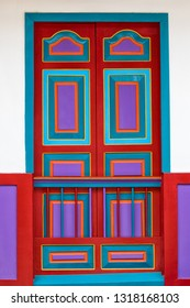 Filandia, Colombia- September 9, 2018: colourful painted wooden door characteristic to the popular tourist town