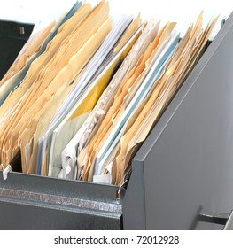 A file cabinet drawer full of files and folders