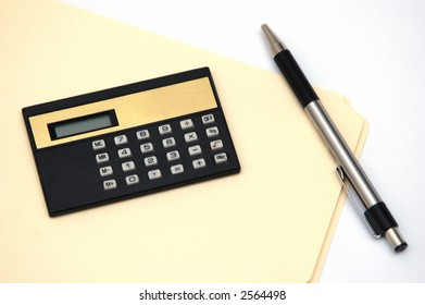 File, calculator and pen against a white background