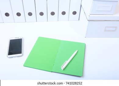 File folder with documents and important document with phone and notebook on isolated background