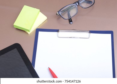 File folder with documents and important document with phone and notebook on isolated background.