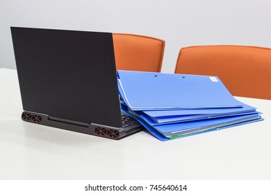 File Folder and Notebook on a white table in meeting room for presentation