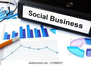 File folder with words Social Business and financial graphs.