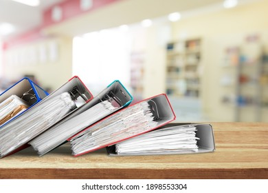 File folders with documents on the office desk