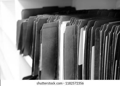 File folders on shelf for office organization